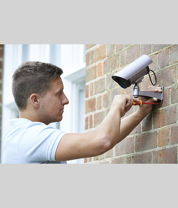 Man installing Surveillance Camera